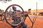 In northern Uganda, with the construction of new roads, bicycle travel is an increasingly important means for hauling water, crops and family members.   This repairman has a busy roadside shop.   After years of brutal insurgency by Joseph Kony's  Lords Liberation Army, the region is now peaceful, and recovering.