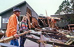 A Wakulla Co. couple laments the destruction of their waterfront home after Hurricane Kate November 21, 1985 .  The family cat which survived the storm in the house cleans herself along side her distraught owners.  Kate, a late November Hurricane,  was latest forming Atlantic hurricane on record at the time and was the second for the area following Hurricane Elena two months earlier.