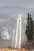 Semi trucks travel the sometimes perilous and hilly James Dalton Highway, Alaska.