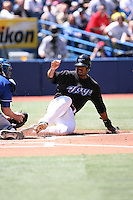 May 24th 2009:  Designated hitter Shannon Stewart (23) of the Toronto Blue Jays slides into the tag of Kansas City Royals catcher John Buck during a game at the Rogers Centre in Toronto, Ontario, Canada .  Photo by:  Mike Janes/Four Seam Images