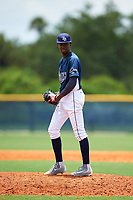 GCL Rays relief pitcher Reynier Montero (15) gets ready to deliver a pitch during the first game of a doubleheader against the GCL Twins on July 18, 2017 at Charlotte Sports Park in Port Charlotte, Florida.  GCL Twins defeated the GCL Rays 11-5 in a continuation of a game that was suspended on July 17th at CenturyLink Sports Complex in Fort Myers, Florida due to inclement weather.  (Mike Janes/Four Seam Images)