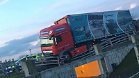 Pictured: The lorry which crashed against a barrier near Aberystwyth, Wales, UK.<br /> Re: A lorry has been left with one wheel hanging over the top of an underpass after crashing into barriers near Aberystwyth, Wales, UK.<br /> Ceredigion council tweeted that Penybont Hill in Aberystwyth had been closed as a result.<br /> The crash happened next to Llwyn yr Eos Primary School in Penparcau and the underpass is used by schoolchildren and traffic was diverted.