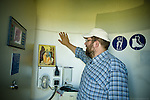 Mr. Juriga looks on the icon of Saint Elias. The wind turbine was named after Saint Elias, a prophet because Mr. Juriga believes that wind energy is prophetic in our need for a clean energy world.  .Mr. Juriga was an outspoken anti-communist in his youth (he learned English from textbooks to escape communism) Mr. Jurigas faith led him to join the Orthodox church and to study theology at a time when anti-communists were prohibited from studying. His vision to create a renewable energy future for the church and community of Vilemov was realised through the support of the church. Mr. Juriga is currently the director of the Orthodox Academy, an institute that helps educate school kids about clean energy in Czech Republic. The Academy runs solar, wind and hydro installations and is supported by the revenue generated from the wind energy...He strongly believes that community involvement and small-scale energy production is essential to the development of a post carbon world. Unfortunately, the system in the Czech Republic and Slovakia is heavily tilted in favour of large energy producers. The process is buried in bureaucracy and controlled by industry heavy weights, meaning it is tough for independent producers or communities to raise the funds and/or complete the process.
