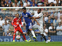 Ashley Williams of Swansea pressures Diego Costa of Chelsea   during the Barclays Premier League match between  Chelsea and Swansea  played at Stamford Bridge, London