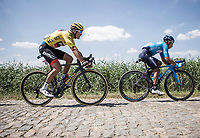 Naïro Quintana (COL/Movistar) and Yellow Jersey Greg Van Avermaet (BEL/BMC) hitting the cobbles. <br /> <br /> Stage 9: Arras Citadelle > Roubaix (154km)<br /> <br /> 105th Tour de France 2018<br /> ©kramon