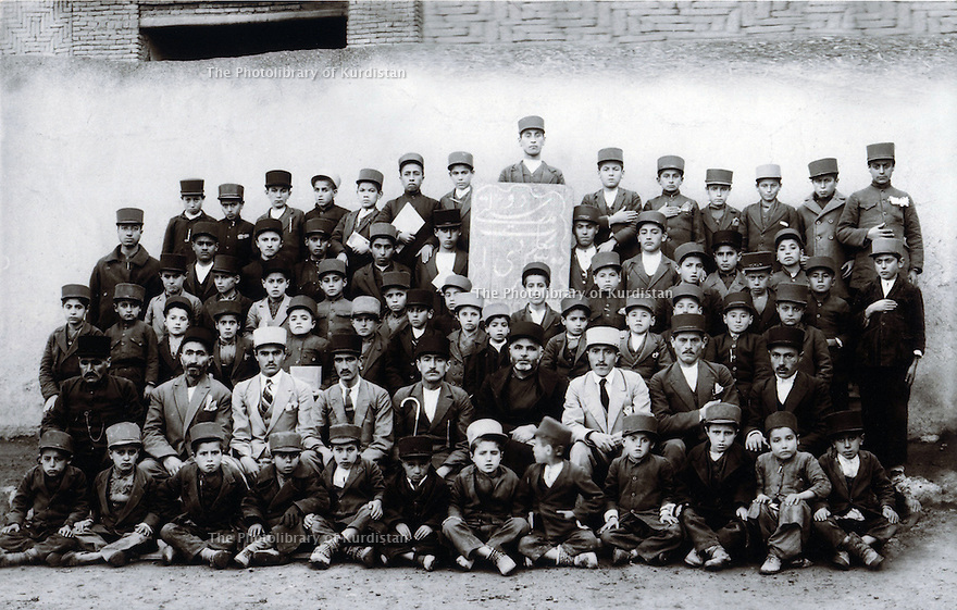 Iran 1938 .In a school of Mahabad, schoolboys with their teachers and Ibrahim Qazi Zadeh, the religious teacher .Iran 1938 .A Mahabad, des eleves et leurs professeurs dont Ibrahim Qazi Zadeh, professeur de religion