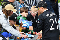 20th March 2021; Dunedin, New Zealand;  Trent Boult wearing Matt Henry's shirt with young fans during the New Zealand Black Caps v Bangladesh International one day cricket match. University Oval, Dunedin.