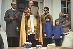 Tichborne Dole. Tichborne, near Arlesford, Hampshire. UK. Annually on Lady Day, March 25th 1970s. The family Roman Catholic priest blesses the dole.