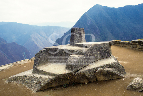 "Machu Picchu, Peru. Inca Intihuatana ""Hitching Post of the Sun"" astronomical observatory carved from natural stone."