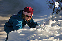 Girl (7-8)  playing in snow, French Alps, France (Licence this image exclusively with Getty: http://www.gettyimages.com/detail/82064690 )