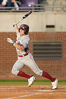 Zeth Stone #5 of the Elon Phoenix follows through on his swing versus the East Carolina Pirates at Clark-LeClair Stadium March 29, 2009 in Greenville, North Carolina. (Photo by Brian Westerholt / Four Seam Images)