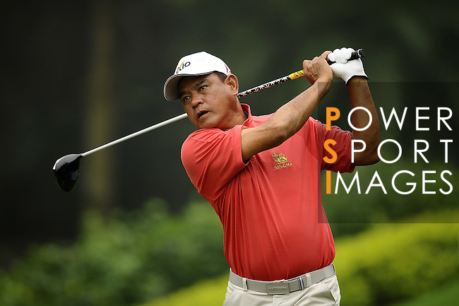 TAIPEI, TAIWAN - NOVEMBER 18:  Boonchu Runangkit of Thailand tees off on the 16th hole during day one of the Fubon Senior Open at Miramar Golf & Country Club on November 18, 2011 in Taipei, Taiwan. Photo by Victor Fraile / The Power of Sport Images