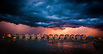 An electrical storm approaches the boat basin at Shell Point beach along the forgotten coast area of Wakulla County in the Florida panhandle.