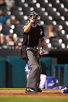 Umpire Brandon Henson makes a call during a game between the Fresno Grizzles and Oklahoma City Dodgers on June 1, 2015 at Chickasaw Bricktown Ballpark in Oklahoma City, Oklahoma.  Fresno defeated Oklahoma City 14-1.  (Mike Janes/Four Seam Images)