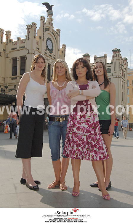 PICTURES FROM SOLARPIX.COM..PICTURES FROM SOLARPIX.COM..Jacqueline Gold, owner of Ann summers at her store in Valencia with three employees during filming for the brand new LIvingTV show, Break With The Boss. They are pictured at the Valencia railway station. .L to r:.Andrea Mann, white top..Eve Tucker, pink top..Jacqueline Gold..Viv Benson, green top.DATE: 13/10/2006-JOB REF: 2920-ITS.