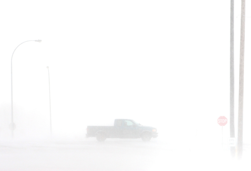 A truck leaves Regina on the Trans-Canada Highway during a blizzard on Monday, March 6, 2017. THE CANADIAN PRESS/Mark Taylor.