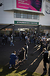 Derby County 1 Nottingham Forest 2, 17/01/2015. iPro Stadium, Championship. Supporters walking past a Starbucks outside the iPro Stadium, pictured before Derby Country's Championship match against Nottingham Forest. The match was won by the visitors by 2 goals to 1, watched by a derby-day crowd of 32,705. The stadium, opened in 1997, was formerly known as Pride Park. Photo by Colin McPherson.