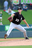 Starting pitcher Steven Matz (33) of the Savannah Sand Gnats throws in a game against the Greenville Drive on Saturday, July 6, 2013, at Fluor Field at the West End in Greenville, South Carolina. Matz is the No. 29 prospect of the New York Mets, according to Baseball America, and was a second-round pick in the 2009 First-Year Player Draft. Matz pitched a complete-game shutout, giving up just three hits, as Savannah won, 3-0. (Tom Priddy/Four Seam Images)