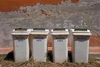 Isola di Pianosa. Pianosa Island..Cassonetti per raccolta differenziata dei rifiuti.Bins for different garbage collection.