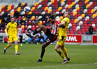 14th February 2021; Brentford Community Stadium, London, England; English Football League Championship Football, Brentford FC versus Barnsley; Michal Helik of Barnsley challenges Ivan Toney of Brentford