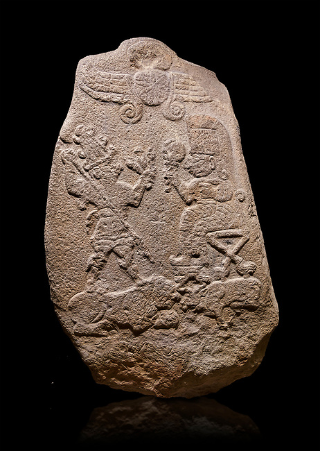 """Aslantepe Hittite relief sculpted Stele. Limestone, Aslantepe, Malatya, 1200-700 B.C. Anatolian Civilizations Museum, Ankara, Turkey.<br /> <br /> Under the winged sun disk, is a god standing on a lion and across the god is a sitting goddess. The hieroglyphs reads """"Karhuhas, the stag god"""" for the god, and """"Kubaba"""" for the Goddess."""