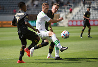 LOS ANGELES, CA - APRIL 17: Tomás Pochettino #7 of Austin FC moves to the ball during a game between Austin FC and Los Angeles FC at Banc of California Stadium on April 17, 2021 in Los Angeles, California.