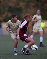 Florida State midfielder Tori Huster (10) dribbles as Boston College forward Victoria DiMartino (1) pressures. Florida State University defeated Boston College, 1-0, at Newton Soccer Field, Newton, MA on October 31, 2010.