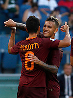 Calcio, Serie A: Roma vs Udinese. Roma, stadio Olimpico, 20 agosto 2016.<br /> Roma's Diego Perotti, left, celebrates with teammate Leandro Paredes after scoring his second goal on a penalty kick during the Italian Serie A football match between Roma and Udinese at Rome's Olympic Stadium, 20 August 2016. Roma won 4-0.<br /> UPDATE IMAGES PRESS/Riccardo De Luca