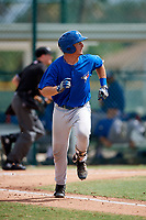 Toronto Blue Jays Hagen Danner (26) runs to first after hitting a home run during an Instructional League game against the Pittsburgh Pirates on October 13, 2017 at Pirate City in Bradenton, Florida.  (Mike Janes/Four Seam Images)