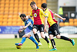St Johnstone v Partick Thistle…13.05.17     SPFL    McDiarmid Park<br />Richie Foster is closed down by Liam Lindsay and Callum Booth<br />Picture by Graeme Hart.<br />Copyright Perthshire Picture Agency<br />Tel: 01738 623350  Mobile: 07990 594431