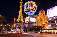 Las Vegas Nevada gambling on The Strip with Paris Casino at night exposure and traffic moving energy of Las Vegas Blvd