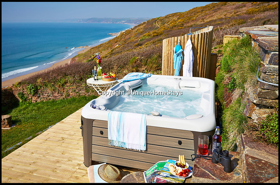BNPS.co.uk (01202 558833)<br /> Pic: UniqueHomeStays/BNPS<br /> <br /> Location, location, location...Tatty shack transformed into £850,000 hideaway.<br /> <br /> A stylish clifftop beach hut with spectacular uninterrupted sea views is on the market for a whopping £850,000.<br /> <br /> The diminutive property, which only sleeps two people and cannot be used as a permanent residence, is the same price as a large four or five-bedroom house elsewhere in the county.<br /> <br /> But its spectacular location and the fact it commands up to £3,595 a week as a luxury holiday let make it a great investment worthy of the seemingly steep price tag.<br /> <br /> Seaglass overlooks Whitsand Bay, which is known as Cornwall's 'forgotten corner', with spectacular 180-degree seaviews, perfect for watching the sun set over the sea.<br /> <br /> Saavy developers Adam and Katherine Wooler bought the land with a derelict chalet in June 2013 and spent five months replacing the old run-down hut with a new luxury timber-clad one.
