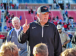 Southern Methodist Mustangs head coach, JUNE JONES, gives the team a pep talk after the game between the Memphis Tigers and the Southern Methodist Mustangs at the Gerald J. Ford Stadium in Dallas, Texas. Memphis defeats SMU 48 to 3.