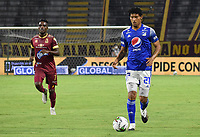 IBAGUE - COLOMBIA, 06-10-2020: Carlos Pereira de Millonarios en acción durante el partido entre Deportes Tolima y Millonarios por la fecha 12 de la Liga BetPlay DIMAYOR 2020 jugado en el estadio Manuel Murillo Toro de la ciudad de Ibagué. / Carlos Pereira of Millonarios in action during match for the date 12 between Deportes Tolima and Millonarios of BetPlay DIMAYOR League 2020 played at Manuel Murillo Toro stadium in Ibague city.  Photo: VizzorImage / Joan Stiven Orjuela / Cont