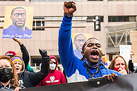 MARCH 28 - Minneapolis, MN: Protests and demonstrators march outside the Hennepin County Courthouse a day before the start Derek Chauvin Trial on March 28, 2021 in  Minneapolis, Minnesota. <br /> CAP/MPI/IS/CT<br /> ©CT/IS/MPI/Capital Pictures