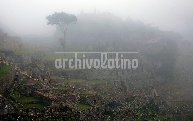 Clouds settle over the ruins of Machu Picchu near Aguas Calientes, Peru, on May 18, 2008. Machu Picchu, often referred to as the ?Lost City of the Incas,? is a pre-Colombian Inca site situated on a mountain ridge above the Urubamba Valley. Visits to Peru?s top tourist destination have more than doubled in the last decade to 800,000 people.