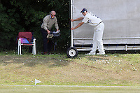 A spectator changes his position as Billy Godleman of Essex moves the sightscreen - Essex CCC 2nd XI vs Surrey CCC 2nd XI - Second XI Championship Cricket at Coggeshall Cricket Club - 14/06/11 - MANDATORY CREDIT: Gavin Ellis/TGSPHOTO - Self billing applies where appropriate - Tel: 0845 094 6026