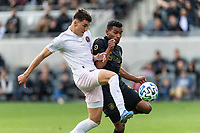 LOS ANGELES, CA - MARCH 01: Robbie Robinson #19 of Inter Miami CF and Eddie Segura #4 of LAFC compete for the ball during a game between Inter Miami CF and Los Angeles FC at Banc of California Stadium on March 01, 2020 in Los Angeles, California.
