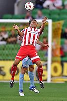 MELBOURNE, AUSTRALIA - FEBRUARY 12: John Aloisi of the Heart heads the ball in the round 27 A-League match between the Melbourne Heart and Sydney FC at AAMI Park on February 12, 2011 in Melbourne, Australia. (Photo Sydney Low / AsteriskImages.com)