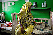 A woman is seen taking care of an infant in the pediatrics ward of Duncan Hospital in Raxaul of East Champaran district of Bihar, India. Since 2008 the Foundation and Geneva Global have been investing in the training of medical staff to improve the lives of people living in 600+ villages in the region. The NGOs are delivering cost effective interventions to address treatment, care and prevention of diseases, disability and preventable deaths amongst infants, adolescent girls and women of child-bearing age. There is statistical and anecdotal evidence that there have been vast improvements and a total of 40-50% increased immunization for all children under 6 has meant that communities can be serviced and educated long term. Photograph: Sanjit Das/Panos for Legatum Foundation