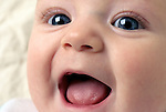 close up of a smiling baby's face