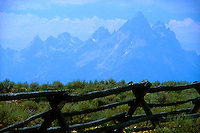 Border fence with mountains in background<br />