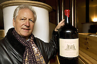 "Switzerland. Canton Ticino. Besazio. Luigi Zanini. Wine grower and producer of the ""Castello Luigi"".  Cellar. Melchior bottle. An 18 liter size bottle of red Merlot and Cabernet wine. © 2008 Didier Ruef"