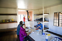 Hikers eating breakfast in their cabin in the Haleakala Crater