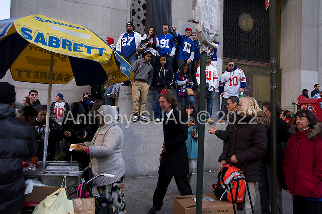 New York, New York<br /> February 7, 2012<br /> <br /> Parade for the New York Giants who won the Super Bowl on Sunday against the New England Patriots. Fans gather on Worth Street and Centre St to over the look the parade as it passes by Thomas Paine Park.