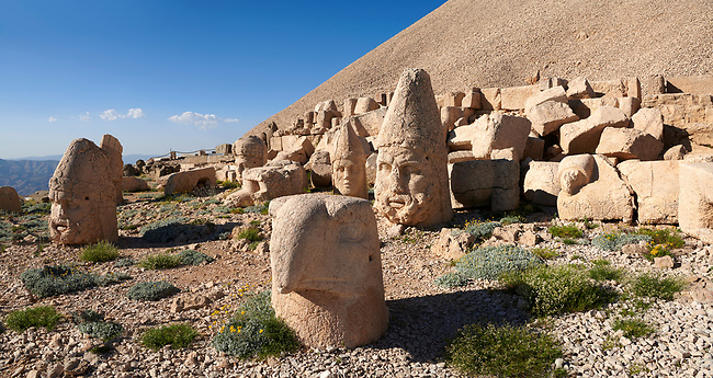 Statue head, from front, of an eagle, Herakles & Apollo, & Zeus (left), in front of the 62 BC Royal Tomb of King Antiochus I Theos of Commagene, west Terrace, Mount Nemrut or Nemrud Dagi summit, near Adıyaman, Turkey