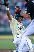 Vanderbilt Commodores second baseman Harrison Ray (2) slides into third base during Game 12 of the NCAA College World Series against the Louisville Cardinals on June 21, 2019 at TD Ameritrade Park in Omaha, Nebraska. Vanderbilt defeated Louisville 3-2. (Andrew Woolley/Four Seam Images)