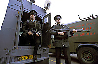 An armed RUC officer stood beside his armoured personnel landrover in Northern Ireland. This image may only be used to portray the subject in a positive manner..©shoutpictures.com..john@shoutpictures.com