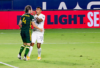 CARSON, CA - OCTOBER 07: Jorge Villafana #4 of the Portland Timbers and Julian Araujo #22 of the Los Angeles Galaxy during a game between Portland Timbers and Los Angeles Galaxy at Dignity Heath Sports Park on October 07, 2020 in Carson, California.