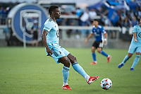 SAN JOSE, CA - AUGUST 17: Bakaye Dibassy #12 of Minnesota United passes the ball during a game between San Jose Earthquakes and Minnesota United FC at PayPal Park on August 17, 2021 in San Jose, California.